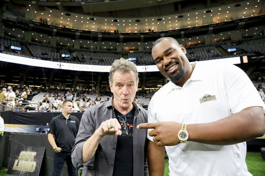 Actor Bryan Cranston poses with former New Orleans Saints guard Jahri Evans prior to the New Orleans Saints vs. Dallas Cowboys Sunday Night Football game on Sunday, Sept. 29, 2019.