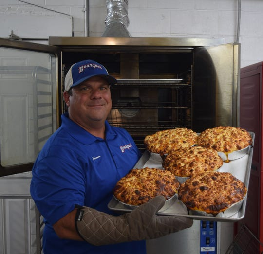 Shannon Bourque holds his family's famous Jalapeno Sausage Cheese Bread.