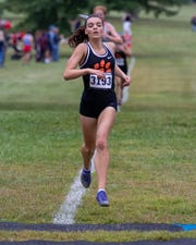 Brighton's Katie Carothers leads Livingston County girls cross country runners with a time of 19:11.6.