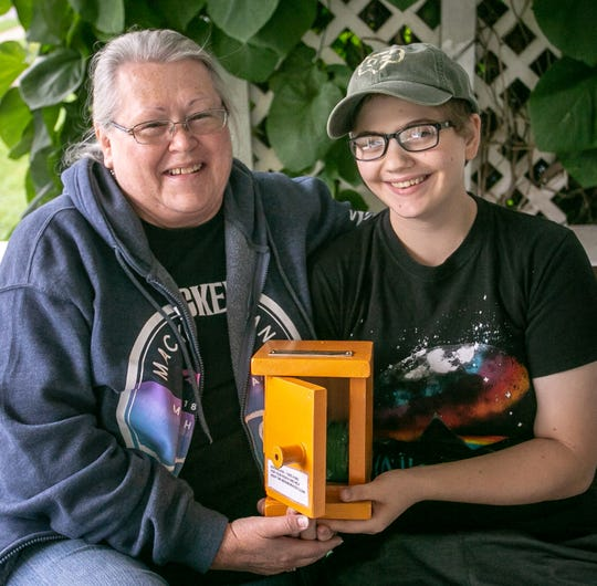 Becky LaBrecque, and Cierra Haughton 18, of  Scouts Heart of Michigan Troop 30273, show her Gold Awrd project, a dog waste station box to help keep her Eastside neighborhood clean, Saturday, Sept. 28, 2019, Lansing, MI.
