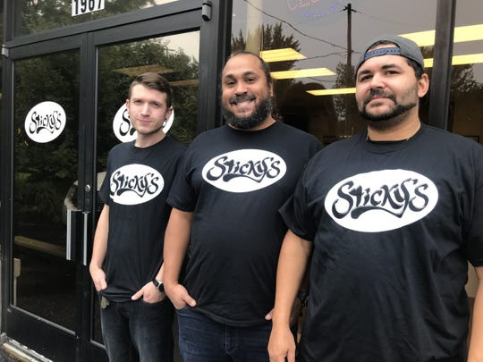 Business partners (from left) Adam Friedrich, Claude Card and Troy Howard will open Sticky's, a brunch restaurant in Holt, this week.