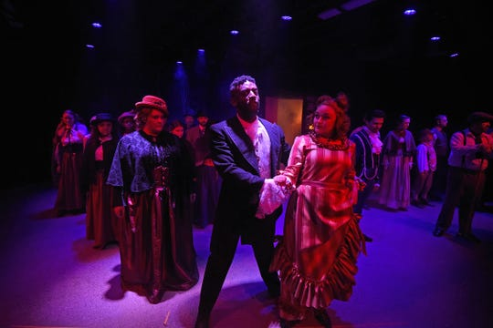 The cast of Sweeney Todd: The Demon Barber of Fleet Street run through a musical scene Monday night during rehearsal.