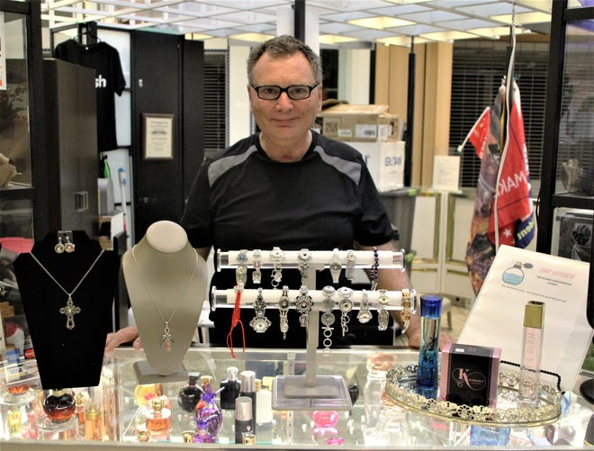 Bret Kuchar is the owner and operator of Snap 2 It Snap Jewelry, located at the Marion Centre Mall, 1395 Marion-Waldo Road. The Snap 2 It jewelry comes in necklaces, rings, earrings, and bracelets with interchangeable charms that can be purchased separately. In addition to jewelry, Kuchar and his wife sell a line of perfume, collectible swords and knives, and political memorabilia at the kiosk in the mall. They've had the business in Marion for about two years.