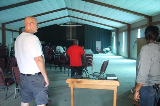 Several people came to One Hope Church Memphis on Sept. 30, 2019, after the church was vandalized with paint over the weekend.