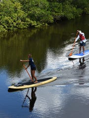 Stand up paddle board instructors from the Old Naples Surf Shop take visitors out onto Henderson Creek. Rookery Bay offered free admission and a host of activities at their Environmental Learning Center on Saturday for National Estuaries Day.