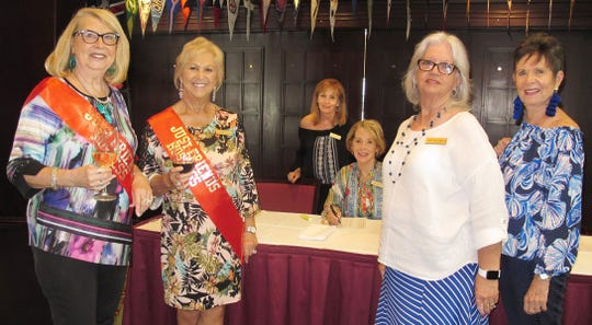 Bonnie Bozzo and Rachel DeHanas greeted Pat Matthews and Jackie Childress at the check-in table.