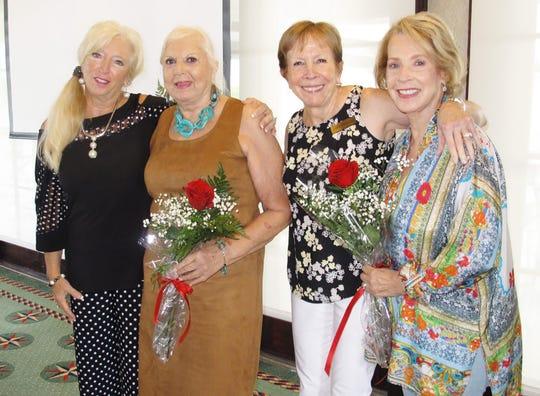 Rose Kraemer, president, with birthday girls, Marie Zoda, Linda Dolinger and Ann Faruol.