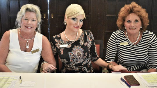 From left, Shelley Drilling, Sara Jean Waggoner and Mary Pounds-Zabkar welcome members.