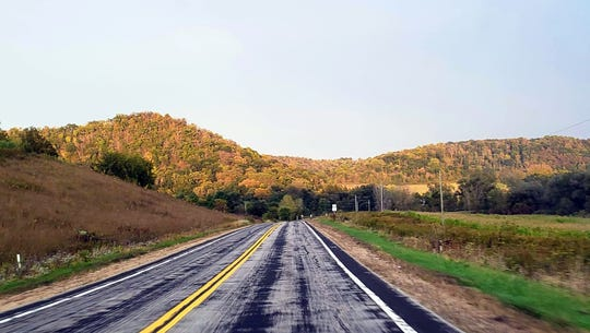 Roads in the Driftless Area wind through the area's signature hills, which were beginning to show signs of fall colors on Sept. 27, 2019.