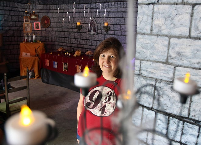 Dody Marriott decorated her garage at her home on Capitol Drive in Hartland to look like the Hogwarts school from the Harry Potter book series. Marriott encourages kids on Halloween to make their way through her display.