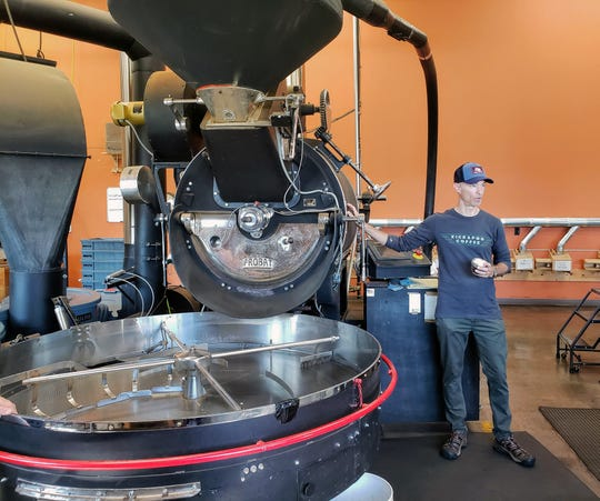 Jay Skrede describes the roasting process at Kickapoo Coffee Roasters in Viroqua during a tour on Sept. 28, 2019.