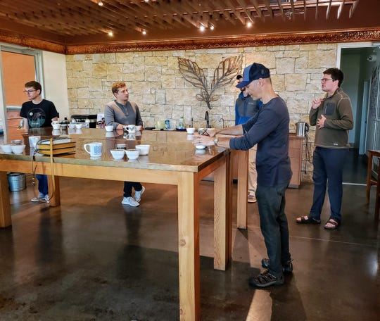 Jay Skrede, second from right, prepares coffee for a tasting at Kickapoo Coffee Roasters in Viroqua on Sept. 29, 2019.