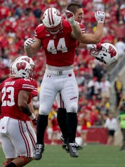 Wisconsin fullback John Chenal celebrates a touchdown against Michigan on Sept. 21. Chenal and Mason Stokke have combined to fill the shoes of Alec Ingold, who now plays in the NFL.