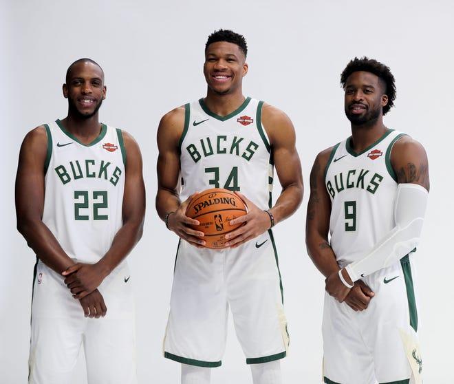 Khris Middleton, Giannis Antetokounmpo and Wesley Matthews smile for the cameras  during the Milwaukee Bucks media day  at Fiserv Forum Monday.