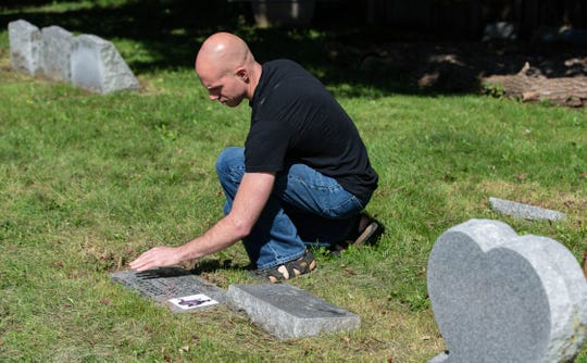 Brennan Rowe, President of Pet Lawn Inc., a pet cemetery and crematorium, takes care of the cemetery grounds on Saturday, Sept. 28, 2019.