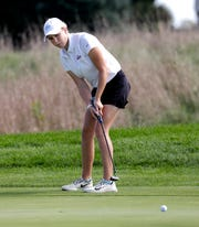 Elise Hoven, Cedarburg, putts during the North Shore Conference girls golf tournament as Washington County Golf Course, Tuesday, September 24, 2019. 