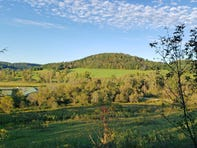 Views from a cabin's porch at Kickapoo Valley Ranch outside La Farge include Driftless Area hills that were beginning to show signs of fall colors on Sept. 28, 2019.
