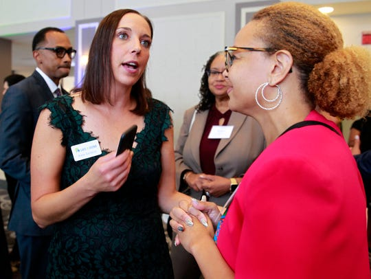 "Safe & Sound Executive Director Katie Sanders, left, talks with Schinika Fitch, right, on Sept. 4 at the organization's ""A Night to Unite: The Power of Community"" event at the Italian Community Center in Milwaukee."