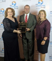 Keep West Monroe Beautiful Chairman Aundi Brown, Ouachita Green Coordinator Stuart Hodnett and West Monroe Mayor Staci Mitchell are pictured with the Circle of Excellence award presented to Keep West Monroe Beautiful on Thursday in Baton Rouge.