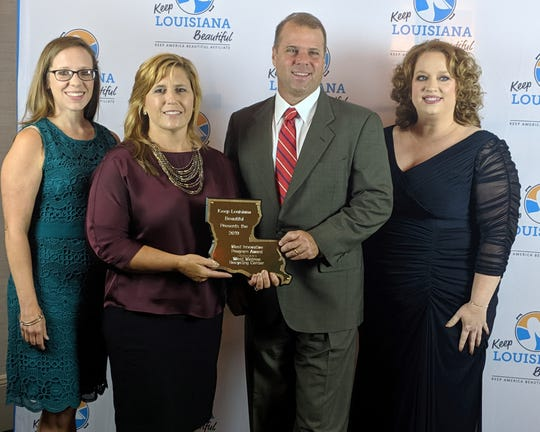 West Monroe Chief of Staff Courtney Hornsby, Mayor Staci Mitchell, Ouachita Green Coordinator Stuart Hodnett and Keep West Monroe Beautiful Chairman Aundi Brown are pictured with the Keep Louisiana Beautiful Most Innovative Program Award, which was presented to the city Thursday in Baton Rouge.