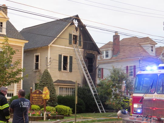 Fire fighters at the scene of an early morning fire on Washington Street in Morristown. Sept. 30, 2019.