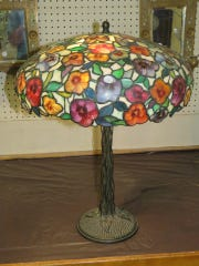 A floral leaded table lamp with vine motif base sold at Berman's last auction for $8,500.