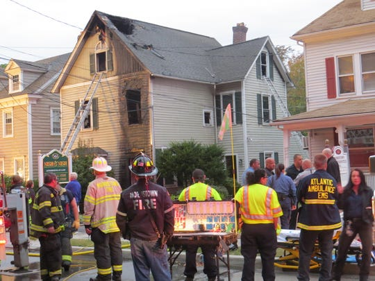 Responders at the scene of an early morning three-alarm fire on Washington Street in Morristown. Sept. 30, 2019