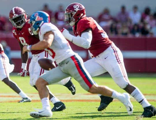 Alabama linebacker Christian Harris (8) and defensive lineman Justin Eboigbe (92) pursue Ole Miss quarterback John Rhys Plumlee (10) at Bryant-Denny Stadium in Tuscaloosa, Ala., on Saturday September 28, 2019.