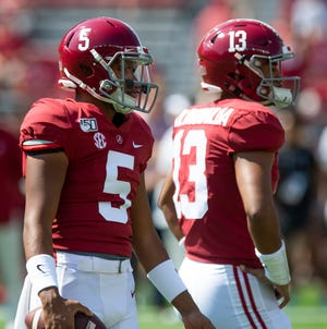 Alabama quarterbacks Taulia Tagovailoa (5) and Tua Tagovailoa (13) watch warm ups before the Ole Miss game at Bryant-Denny Stadium in Tuscaloosa, Ala., on Saturday September 28, 2019.