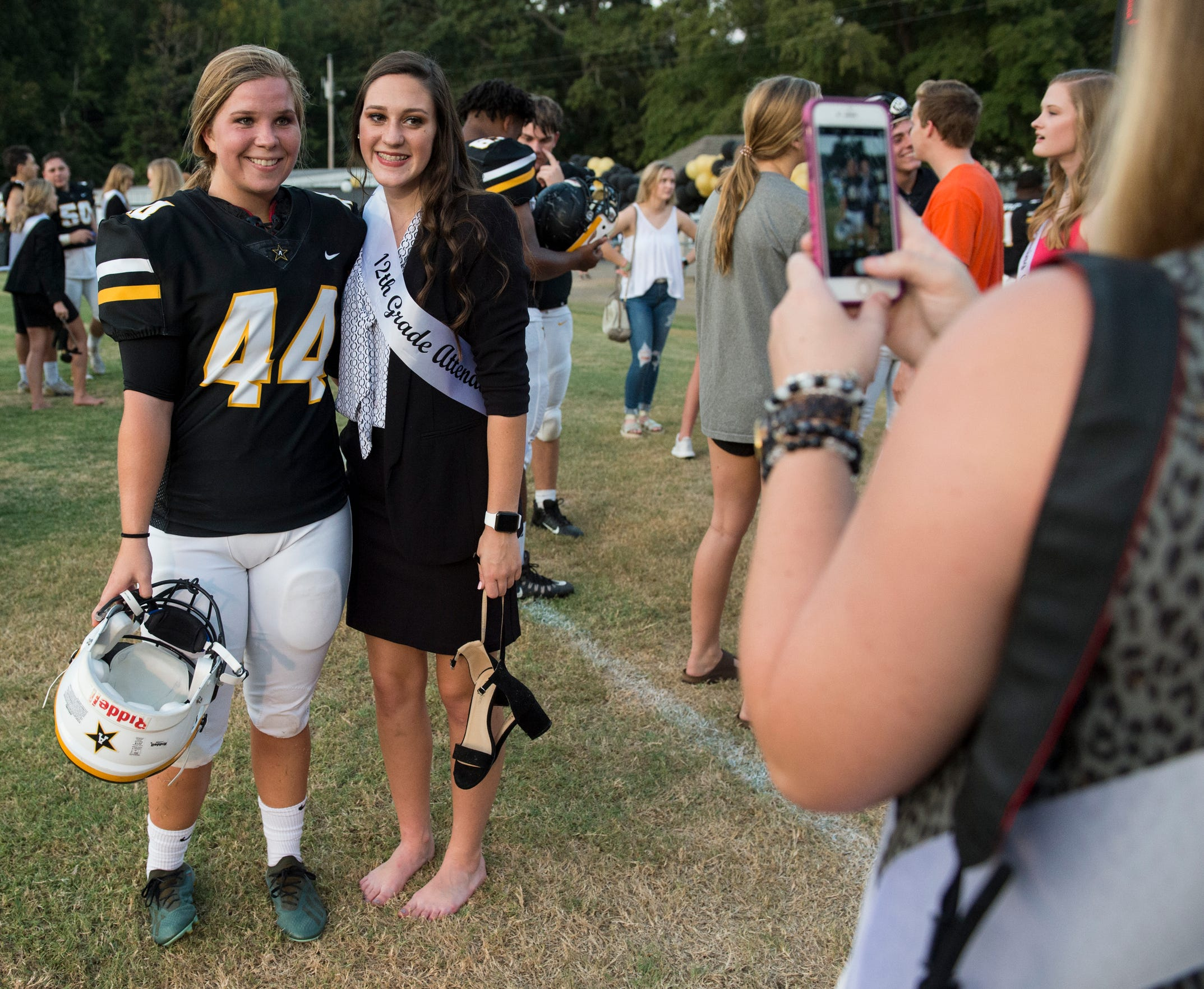 Autauga's Emma Wendland (44) takes a picture with a fellow homecoming attendant at Autauga Academy in Prattville, Ala., on Friday, Sept. 27, 2019. Autauga Academy defeated Tuscaloosa Academy 40-16.