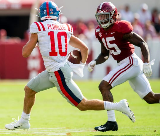 Alabama defensive back Xavier McKinney (15) chases Ole Miss quarterback John Rhys Plumlee (10) at Bryant-Denny Stadium in Tuscaloosa, Ala., on Saturday September 28, 2019.