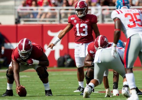 Alabama quarterback Tua Tagovailoa (13) signals from the line behind center Chris Owens (79) at Bryant-Denny Stadium in Tuscaloosa, Ala., on Saturday September 28, 2019.