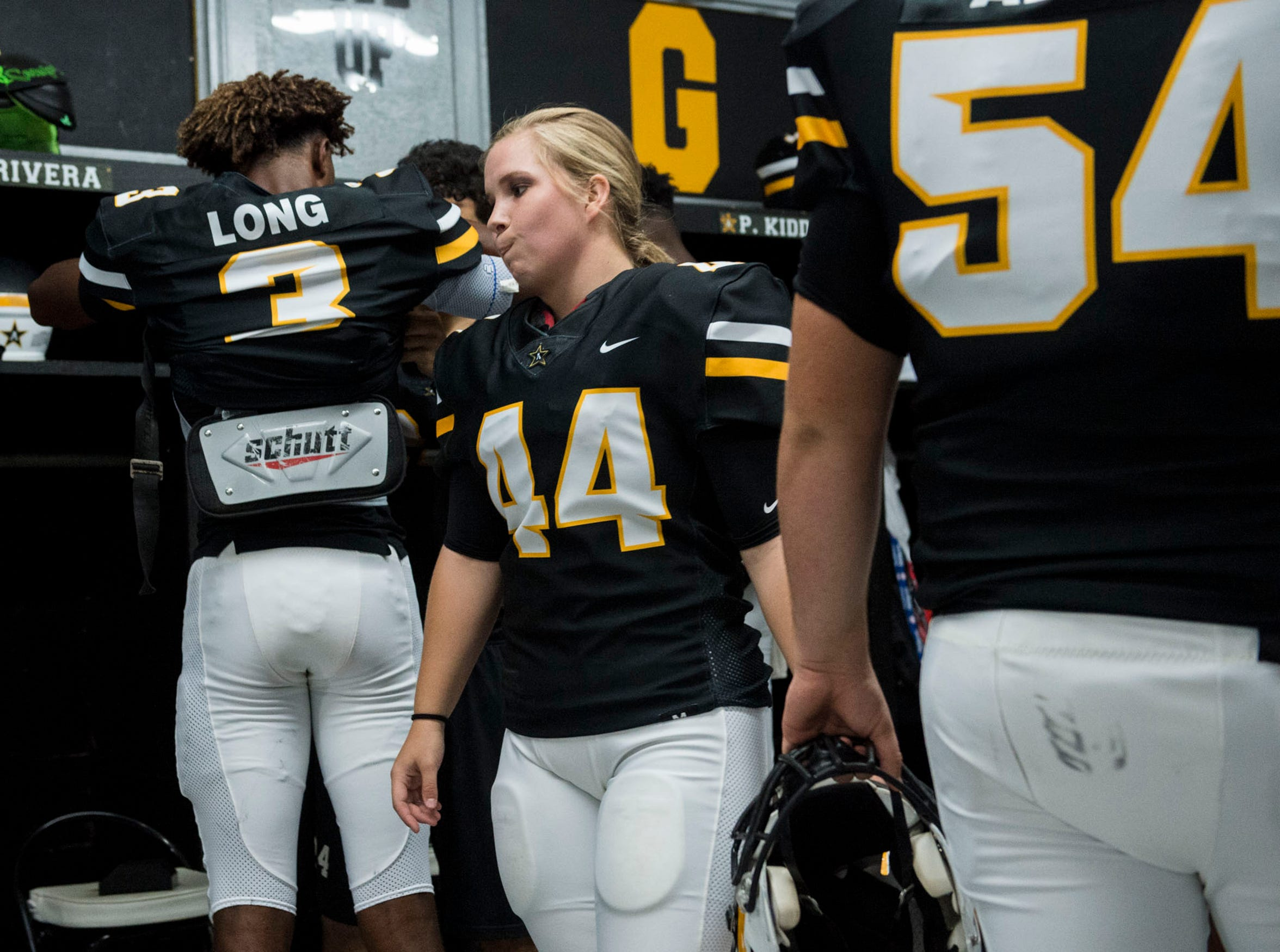 Autauga's Emma Wendland (44) hangs out in the locker room before the game at Autauga Academy in Prattville, Ala., on Friday, Sept. 27, 2019. Autauga Academy defeated Tuscaloosa Academy 40-16.