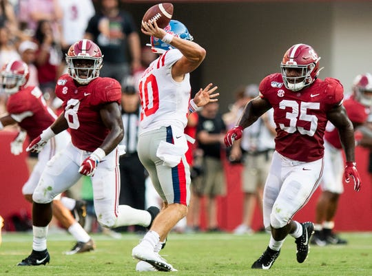 Alabama linebackers Christian Harris (8) and Shane Lee (35) pressure Ole Miss quarterback John Rhys Plumlee (10) at Bryant-Denny Stadium in Tuscaloosa, Ala., on Saturday September 28, 2019.