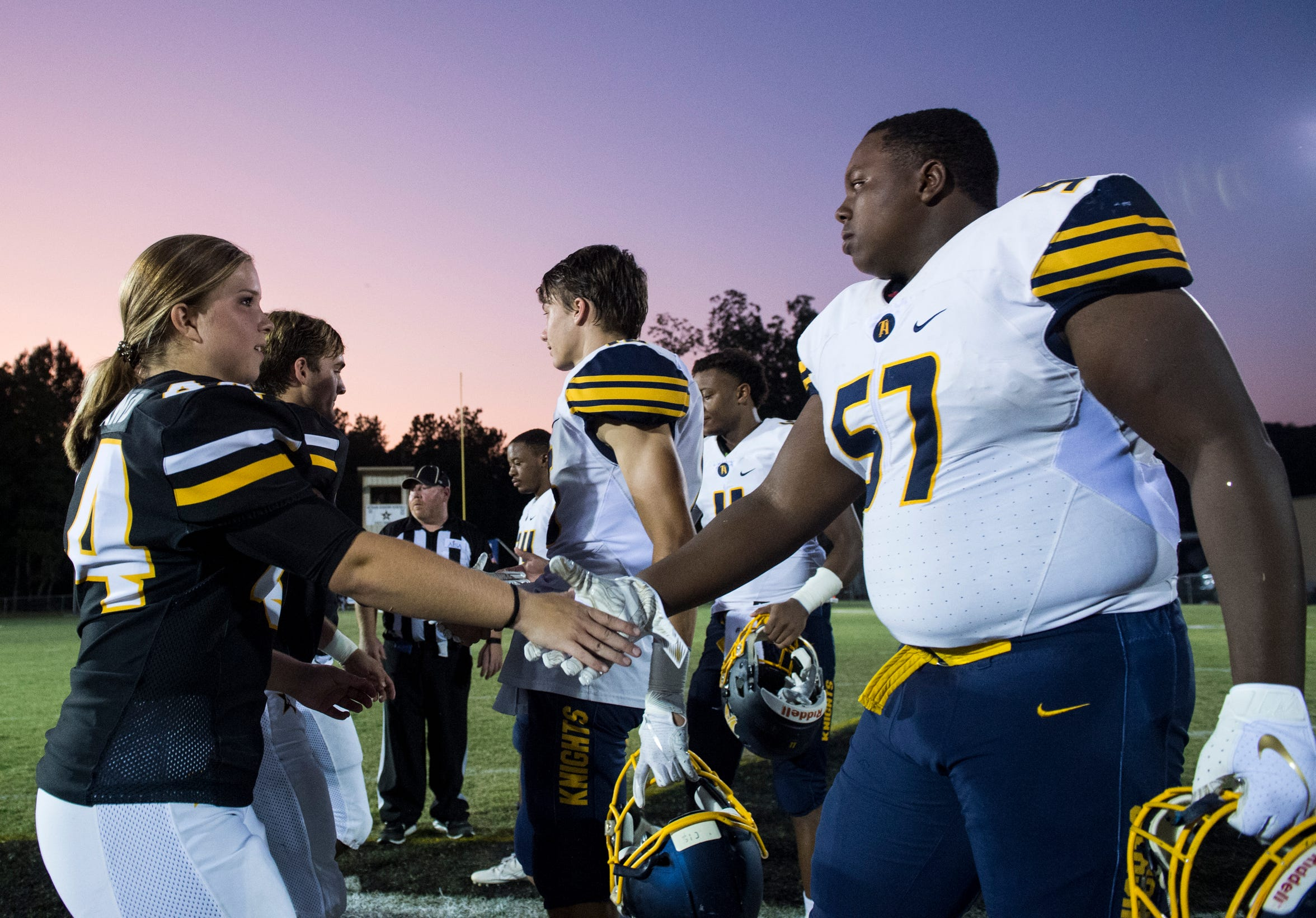 Autauga's Emma Wendland (44) shakes hands with Tuscaloosa Academy players before the coin toss at Autauga Academy in Prattville, Ala., on Friday, Sept. 27, 2019. Autauga Academy defeated Tuscaloosa Academy 40-16.