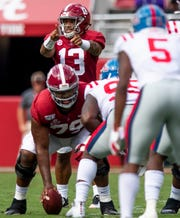 Alabama quarterback Tua Tagovailoa (13) directs from the line against Ole Miss at Bryant-Denny Stadium in Tuscaloosa, Ala., on Saturday September 28, 2019.