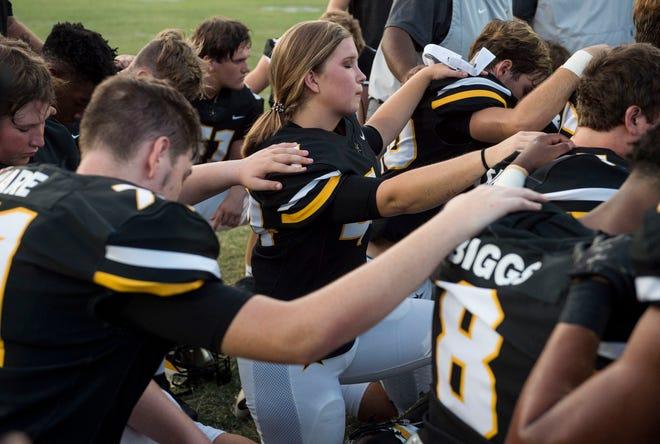 Autauga's  Emma Wendland (44) prays with her team before the game at Autauga Academy in Prattville, Ala., on Friday, Sept. 27, 2019. Autauga Academy defeated Tuscaloosa Academy 40-16.