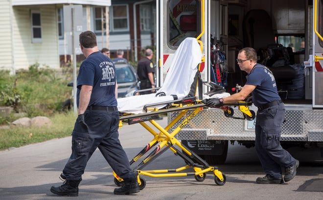 Responders from Heartland Ambulance Service and a unit from the Muncie Fire Department arrive on the scene of a car crash Monday afternoon near 8th and Jefferson Street. Muncie's ambulances began to cover nearly three quarters of the city on Monday over the county.