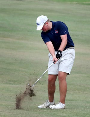 Oakland's Garrett Chumley hits the ball to the green during the District 7 Large Golf tournament at Indian Hills, in Murfreesboro, on Monday Sept. 30, 2019.