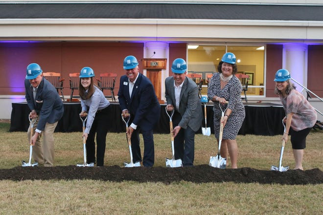 Battle Ground Academy officials break ground on a new center for entrepreneurship and performing arts. From left, Tyler R. Berry IV '87, trustee and former board chairman; Hallie Heiter, director of the Entrepreneurial Leadership Program; Kurt Winstead, current board chairman; Will Kesler, Head of School; Jennifer Helm, chairman of the Fine Arts Department.