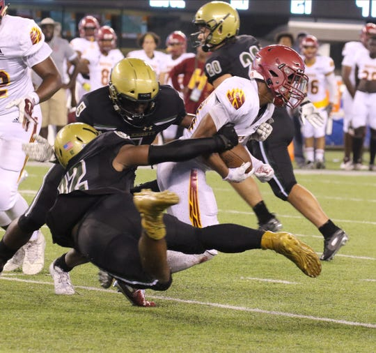 Christian Abraham and Jerry Waters of St. Joseph tackle Jalen Smith of Cardinal Hayes during the Battle for the Bridge High School Football competition at Metlife Stadium in East Rutherford , NJ on September 14, 2019.