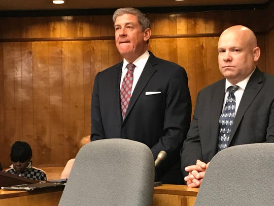 Shawn J. Kelly ( R ) in court with his new attorney, Patrick Jennings