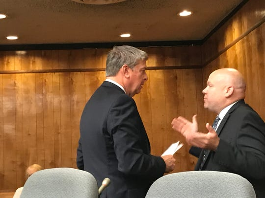 Shawn Kelly ( R ) conferring with his new attorney, Patrick Jennings on Monday.