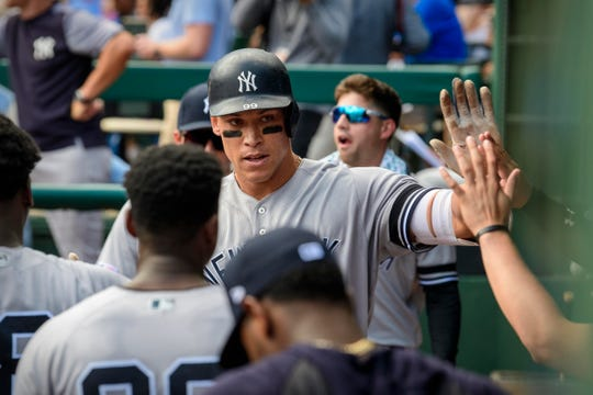 Sep 29, 2019; Arlington, TX, USA; New York Yankees right fielder Aaron Judge (99) celebrates hitting a home run against the Texas Rangers in the final home game at Globe Life Park in Arlington.