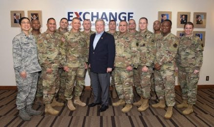 Sergeant Major of the Army Michael A. Grinston and Exchange Director/CEO Tom Shull, center, stand with Soldiers and Airmen assigned to Exchange HQ.