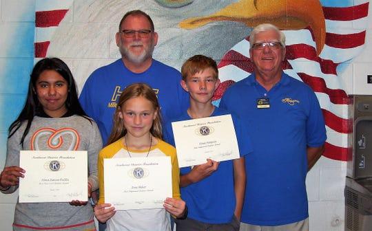 Eighth grader Alexa Zamora-Padilla, sixth grader Zoey Baker, seventh grader Ethan Simpson, Principal Dr. Joe Keith  and Ned Kline