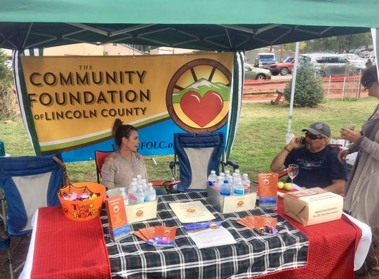 Spreading the word , Community Foundation members man a booth at a local event.