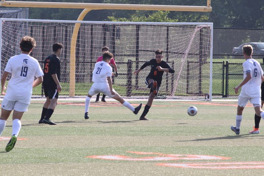 Dearborn junior defender Hassan Safiedine kicks the ball away from a Stevenson offensive possession. Dearborn defeats Stevenson 3-0 on Sept. 30