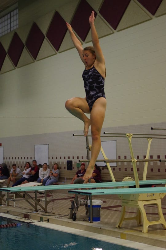 South Lyon East's Sophia Ohland prepares for a dive.