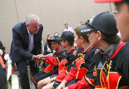 Tod Leiweke, CEO of NHL Seattle, meets players of a local youth hockey team during the announcement that Palm Springs will have a American Hockey League team, September 30, 2019.